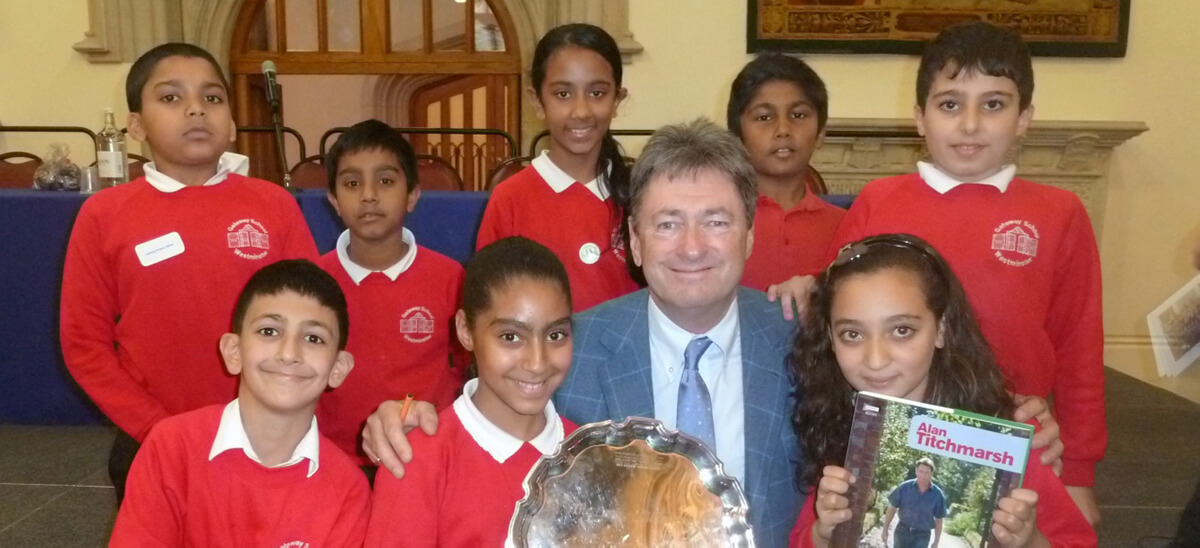 Students with a special award from London Children's Flower Society, presented by Alan Titmarsh